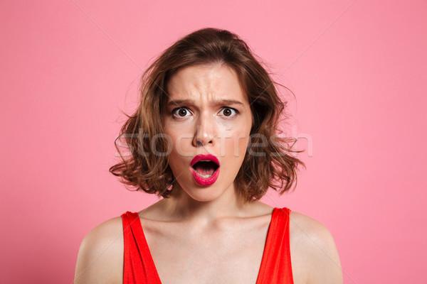 Close up portrait of a shocked pretty woman Stock photo © deandrobot