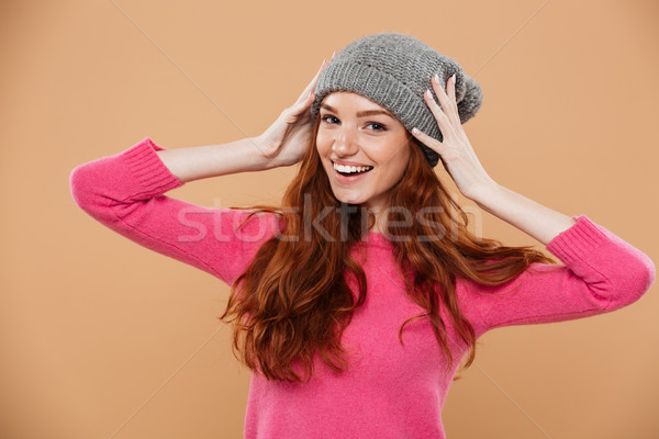 Stock photo: Portrait of a happy pretty redhead girl
