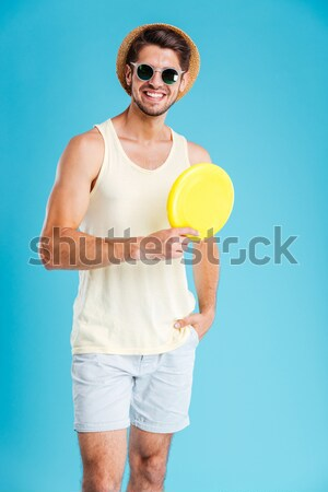 Handsome young man standing with rubber ring Stock photo © deandrobot