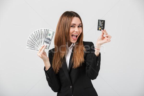 Heureux dame souriant trésorerie dollars Photo stock © deandrobot