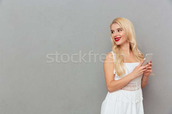 Portrait of a pretty woman looking away at copy space Stock photo © deandrobot