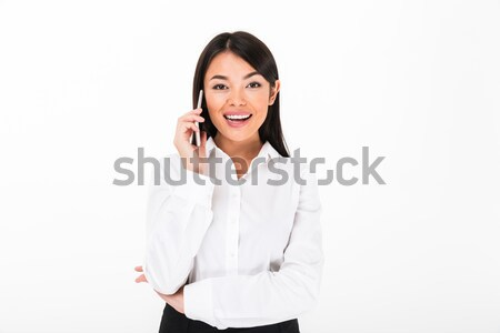 Portrait of a laughing asian businesswoman Stock photo © deandrobot