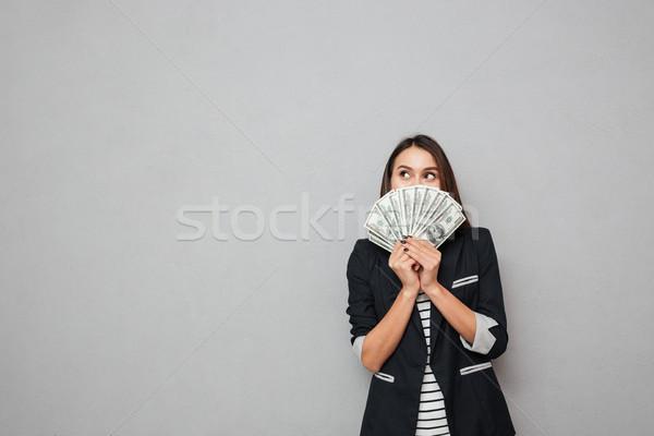 Mosolyog üzletasszony rejtőzködik mögött pénz másfelé néz Stock fotó © deandrobot