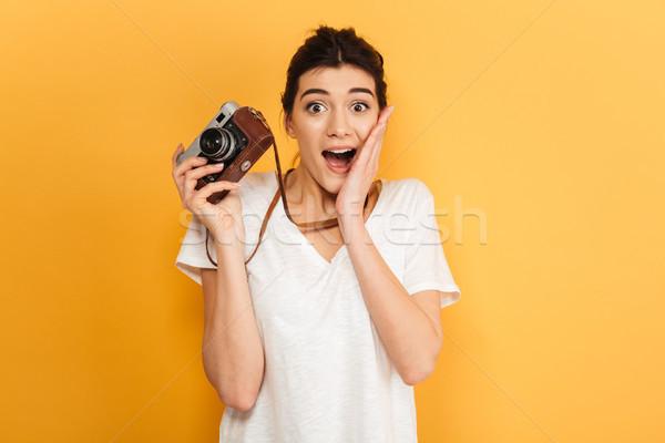 Scioccato giovani pretty woman fotografo immagine piedi Foto d'archivio © deandrobot