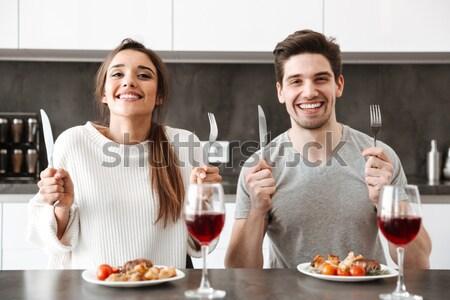 Portret boos paar vergadering keukentafel Stockfoto © deandrobot