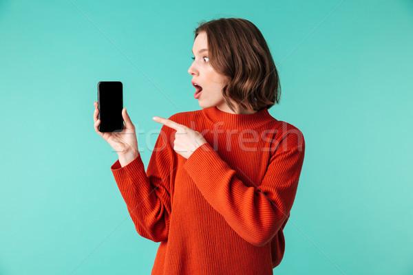Ritratto eccitato maglione punta dito Foto d'archivio © deandrobot