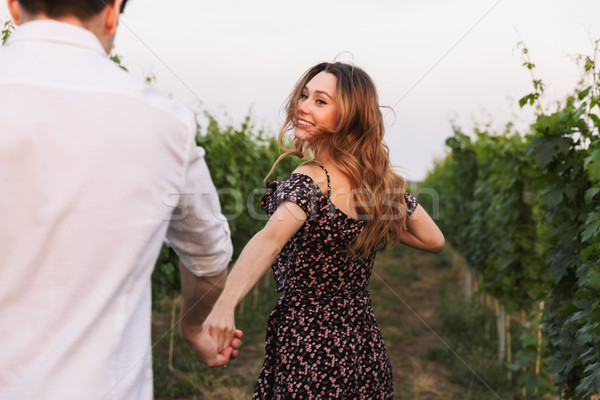 Romantic beautiful couple man and woman dating while walking out Stock photo © deandrobot