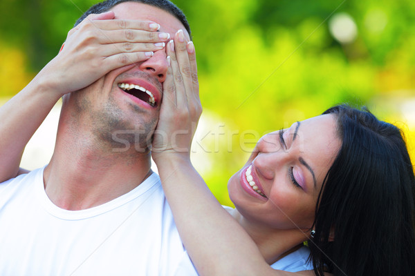 Happy woman holding hands on eyes of her boyfriend Stock photo © deandrobot