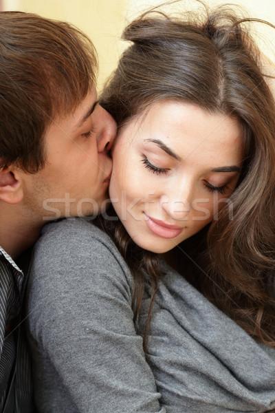 Young man kisses his beautiful girlfriend Stock photo © deandrobot