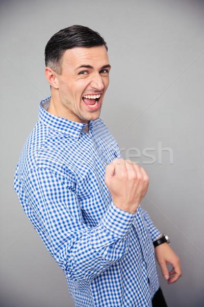 Ritratto uomo vittoria gesto grigio Foto d'archivio © deandrobot
