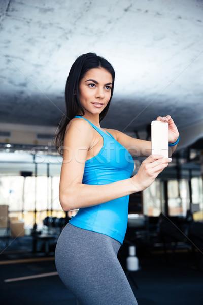 Happy fit woman making selfie photo  Stock photo © deandrobot