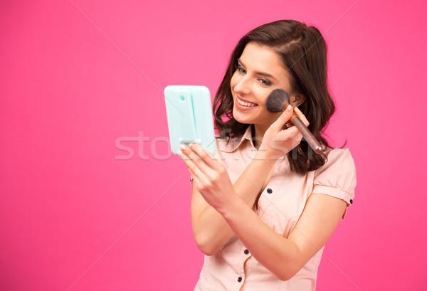Beautiful woman making makeup Stock photo © deandrobot