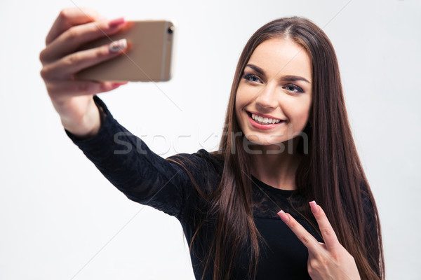 Woman in black dress making selfie photo Stock photo © deandrobot