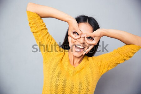 Woman showing horns with her fingers  Stock photo © deandrobot