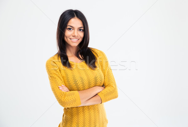 Feliz mujer pie armas doblado Foto stock © deandrobot