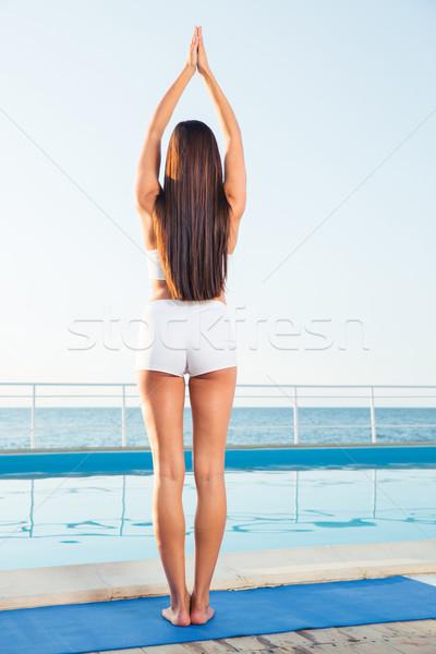 背面図 肖像 少女 立って ヨガのポーズ 屋外 ストックフォト © deandrobot