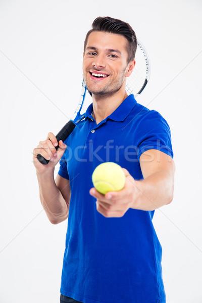 Sportok férfi tart teniszütő labda portré Stock fotó © deandrobot