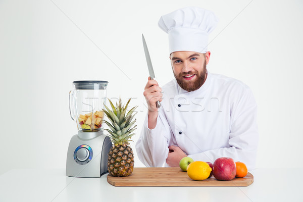 Male chef reading to cutting vegetables Stock photo © deandrobot