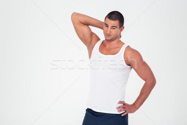 Portrait of a handsome fitness man  Stock photo © deandrobot
