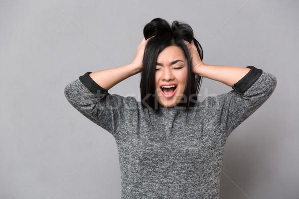 Asya kız çığlık atan güzel gri Stok fotoğraf © deandrobot