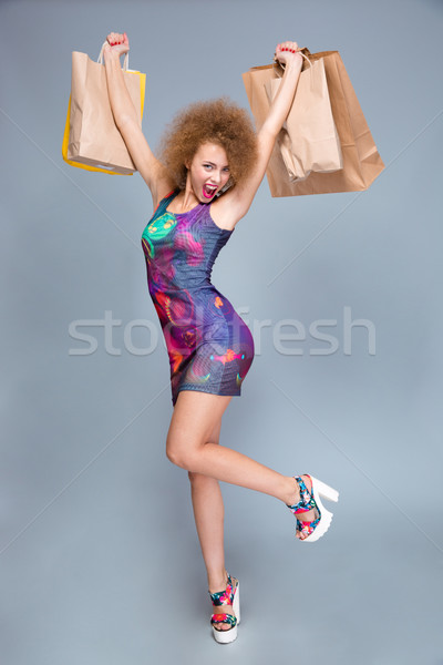 Joyful emotional content female excited after good shopping Stock photo © deandrobot