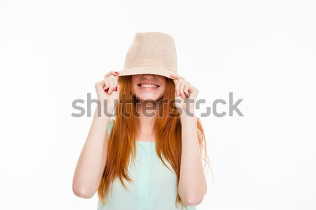 Funny amusing young woman hiding under boonie hat  Stock photo © deandrobot