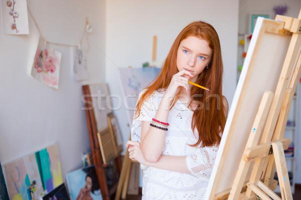 Atraente pensativo feminino artista pensando desenho Foto stock © deandrobot
