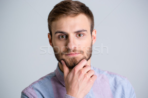 Portrait of handsome thoughtful young man with beard Stock photo © deandrobot