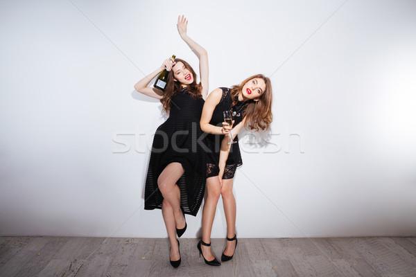 Dois belo bêbado mulheres potável champanhe Foto stock © deandrobot