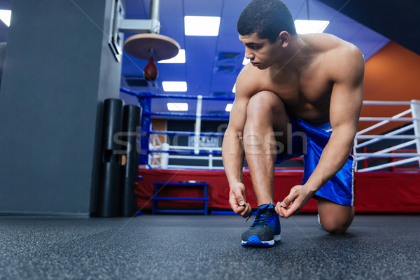 Boxer tying shoelaces Stock photo © deandrobot