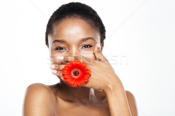 Laughing afro american woman covering her mouth Stock photo © deandrobot