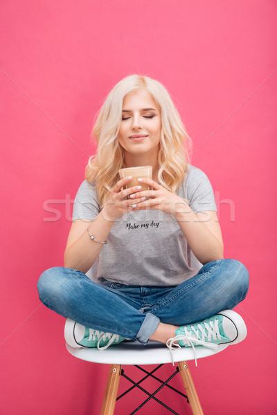 Heureux femme potable cappuccino rose fille Photo stock © deandrobot