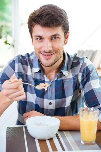 человека еды злаки молоко завтрак Сток-фото © deandrobot