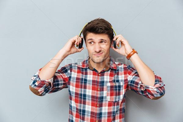 путать несчастный молодым человеком наушники серый Сток-фото © deandrobot