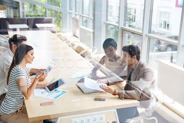 Businesspeople working together in conference room Stock photo © deandrobot