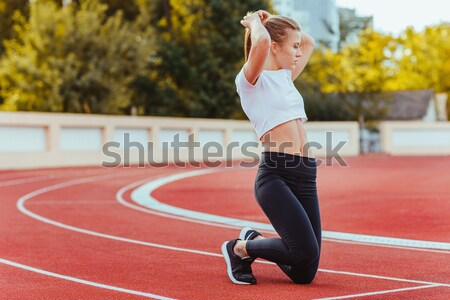 Hátulnézet női futó mobiltelefon zenét hallgat stadion Stock fotó © deandrobot