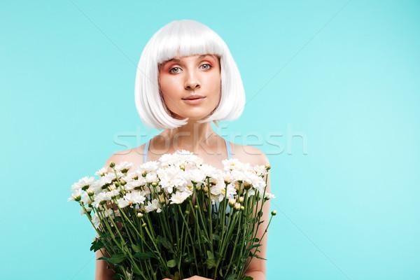 Szőke nő fiatal nő áll tart virágcsokor virágok Stock fotó © deandrobot