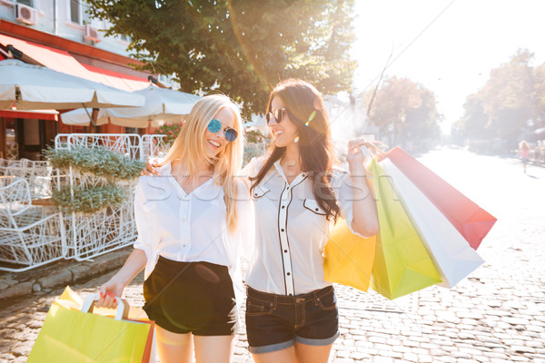 Two young fashion women with shopping bags Stock photo © deandrobot