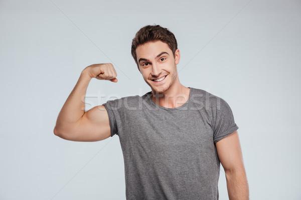 笑みを浮かべて 男 1 腕 アップ 肖像 ストックフォト © deandrobot