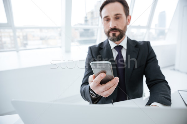 Stock photo: Elderly bearded business man using phone