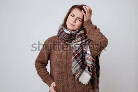 Hasta kadın kazak eşarp dokunmak alın Stok fotoğraf © deandrobot