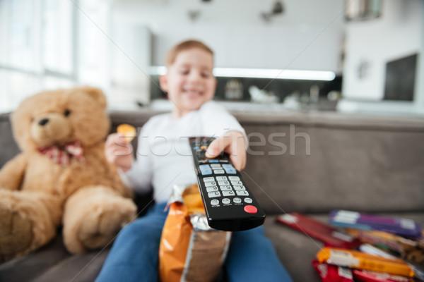 мальчика сидят диван мишка пультом Сток-фото © deandrobot