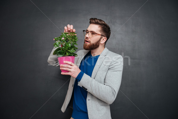 Young hipster with flower Stock photo © deandrobot