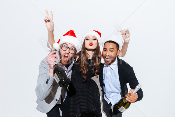 People with bottles of champagne and glasses celebrating new year Stock photo © deandrobot