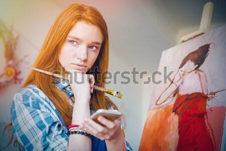 Pretty woman wearing orange dress with golden fish in jar Stock photo © deandrobot
