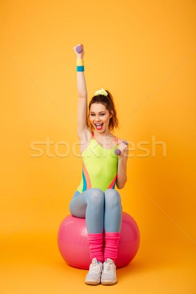 Genç fitness woman poz sarı fotoğraf Stok fotoğraf © deandrobot
