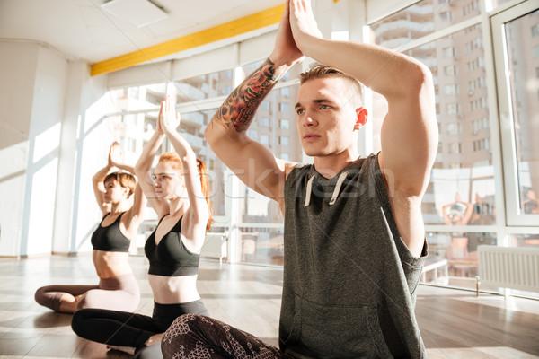 группа людей сидят Lotus создают йога Сток-фото © deandrobot