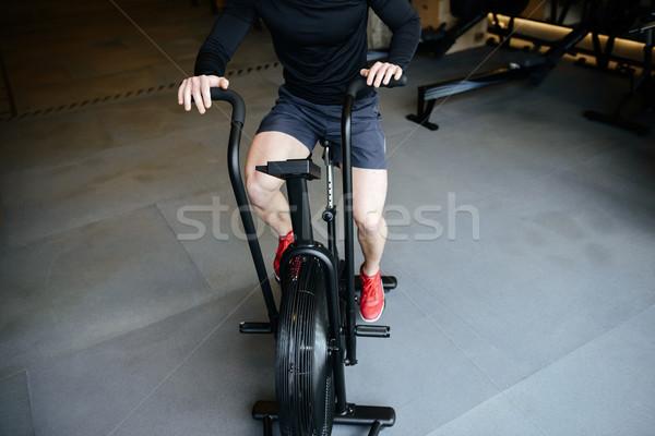 Bild sportlich Mann Fahrrad Fitnessstudio Sport Stock foto © deandrobot