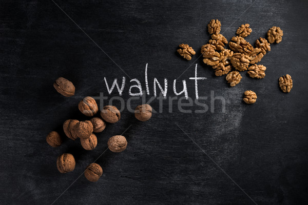 Walnut over dark chalkboard background Stock photo © deandrobot