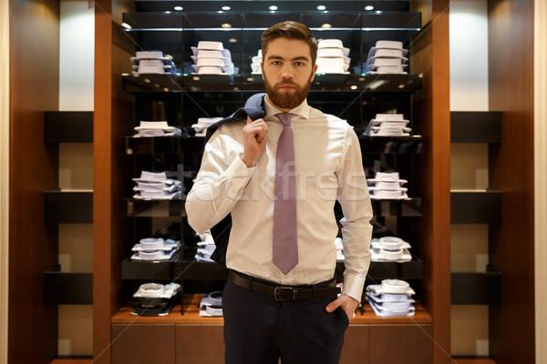 Sério homem camisas jaqueta ombro Foto stock © deandrobot